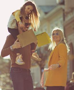 family walking buying apparel clothing